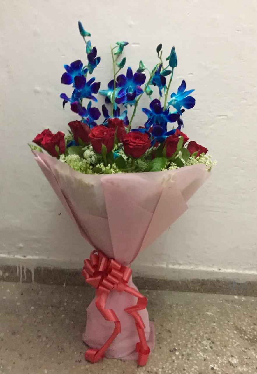 Red Roses & Blue OrcidsFlowers Delivery in Jalahalli Bangalore