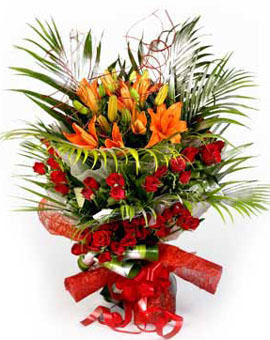 Bunch of 20 Roses & 5 Lilys in Paper PackingFlowers Delivery in Cubban Road Bangalore