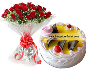 10 Red Roses Bunch  & 1/2KG Pineapple CakeFlowers Delivery in Jalahalli Bangalore
