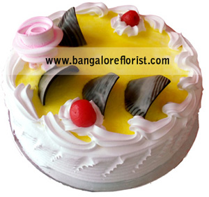 Eggless Pineapple Cake send-flower-Shanthinagar
