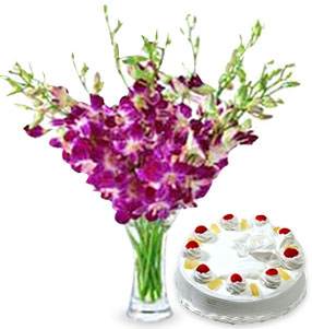 10 Purple Orchids in Vase & 1 kg Cake (of your choice)